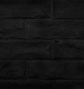 A black brick wall
