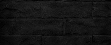 A black brick wall