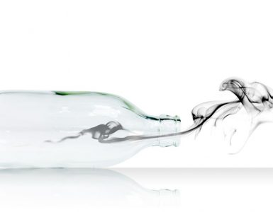 A glass bottle and gas