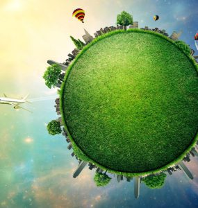 A stylised planet Earth showing green habitat against human developments