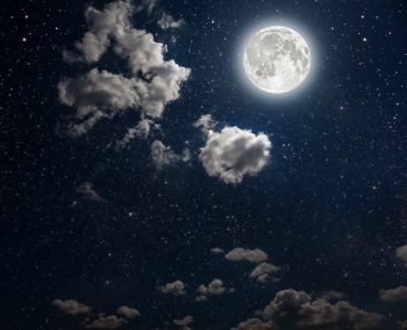 The night sky of with a full Moon, stars and some cloud