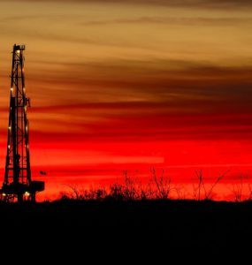 onshore oil and gas against a red sky