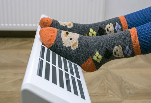 warming feet close to an electric heater