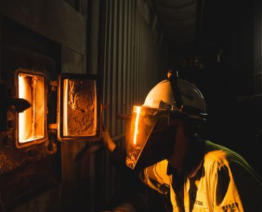 worker looking into furnace