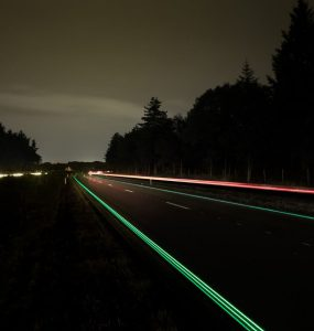 A motorway illuminated at night by solar power.