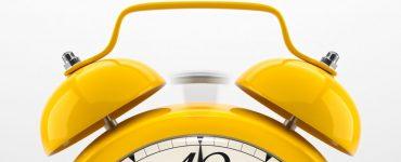 A yellow alarm clock